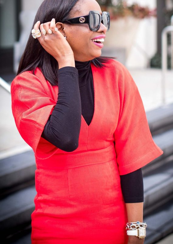 Atlanta style blogger wearing a red work dress with spanx hosiery, black booties, black gucci sunglasses, a turtleneck top and chanel top. -13