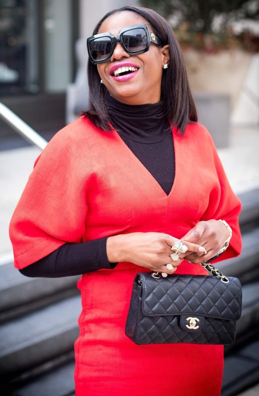 Atlanta style blogger wearing a red work dress with spanx hosiery, black booties, black gucci sunglasses, a turtleneck top and chanel top. -15