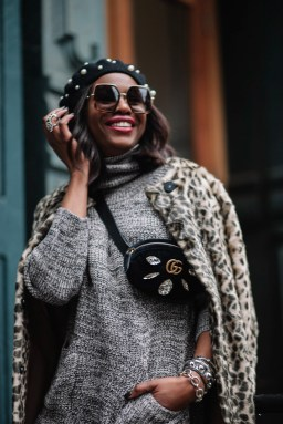 Fashion blogger wearing sweater dress with gucci waist bag and gucci sunglasses during NYFW10