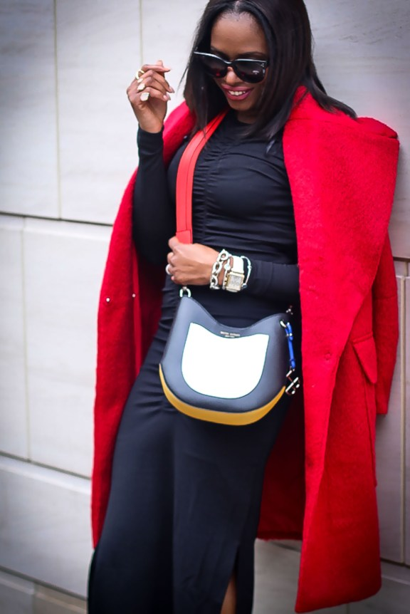 How to style a red coat for NYFW. Red H&M coat worn with black fitted midi dress, snake skin pumps and coloful bag by Atlanta fashion and lifestyle blogger -8