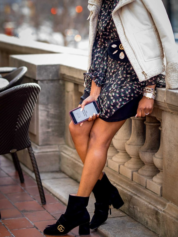 how to style a floral mini dress in the winter. floral dress worn with gucci suede booties, gucci waist bag and le spec sunglasses-7