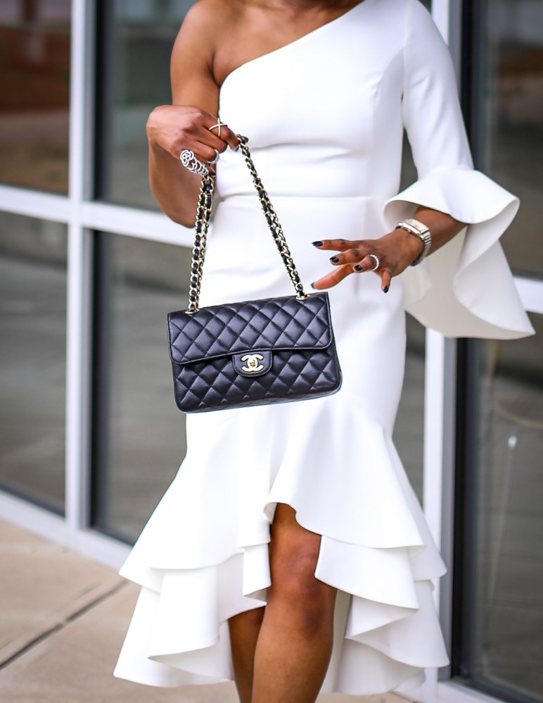 Fashion blogger wearing a white ruffle dress by frame and partners. Dress worn with Moschino pointed sunglasses, chanel bag and christian dior pumps. #Atlanta blogger -14