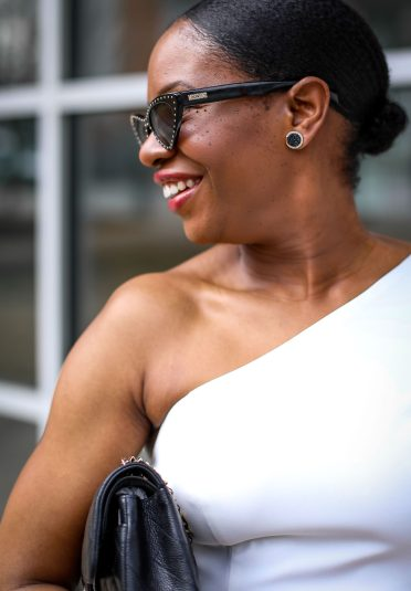 Fashion blogger wearing a white ruffle dress by frame and partners. Dress worn with Moschino pointed sunglasses, chanel bag and christian dior pumps. #Atlanta blogger -25