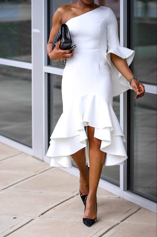 Fashion blogger wearing a white ruffle dress by frame and partners. Dress worn with Moschino pointed sunglasses, chanel bag and christian dior pumps. #Atlanta blogger -7