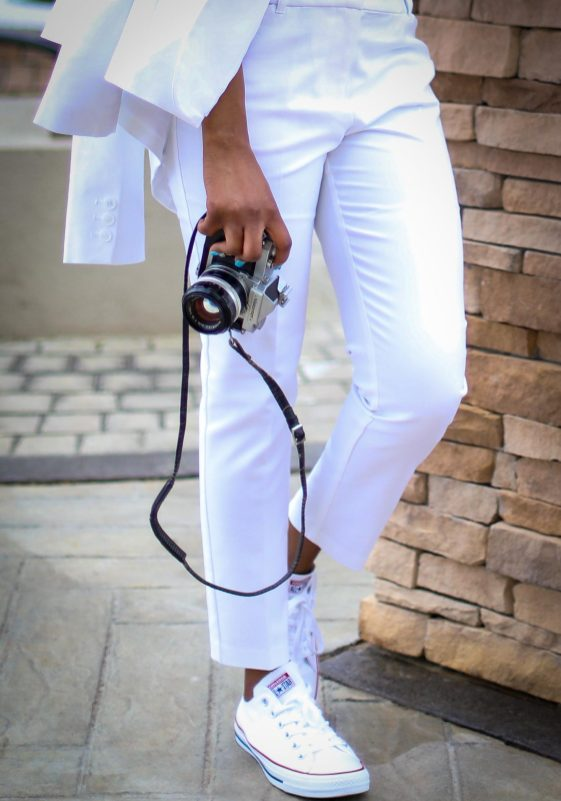 Atlanta fashion blogger wearing a white spring suit and blue and white gingham blouse, matched with white converse sneakers exploring a vineyard-13