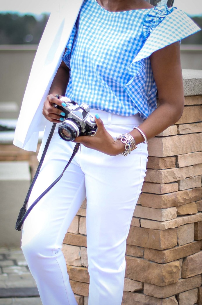 Atlanta fashion blogger wearing a white spring suit and blue and white gingham blouse, matched with white converse sneakers exploring a vineyard-15