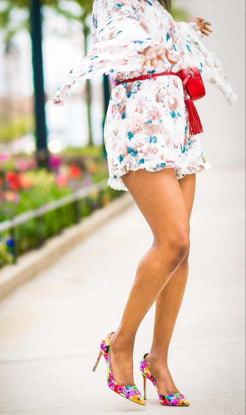 how to wear a floral romper during the spring summer. jumpsuit worn with floral pumps by manolo blahnik, red ysl belt bag, and lespac cat eye sunglasses-14