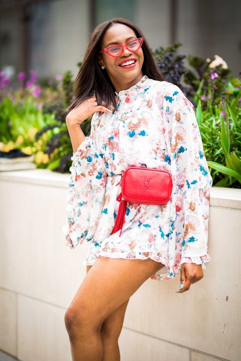 how to wear a floral romper during the spring summer. jumpsuit worn with floral pumps by manolo blahnik, red ysl belt bag, and lespac cat eye sunglasses-23