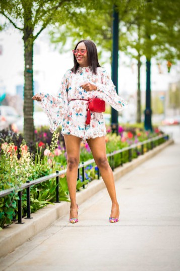 how to wear a floral romper during the spring summer. jumpsuit worn with floral pumps by manolo blahnik, red ysl belt bag, and lespac cat eye sunglasses-8