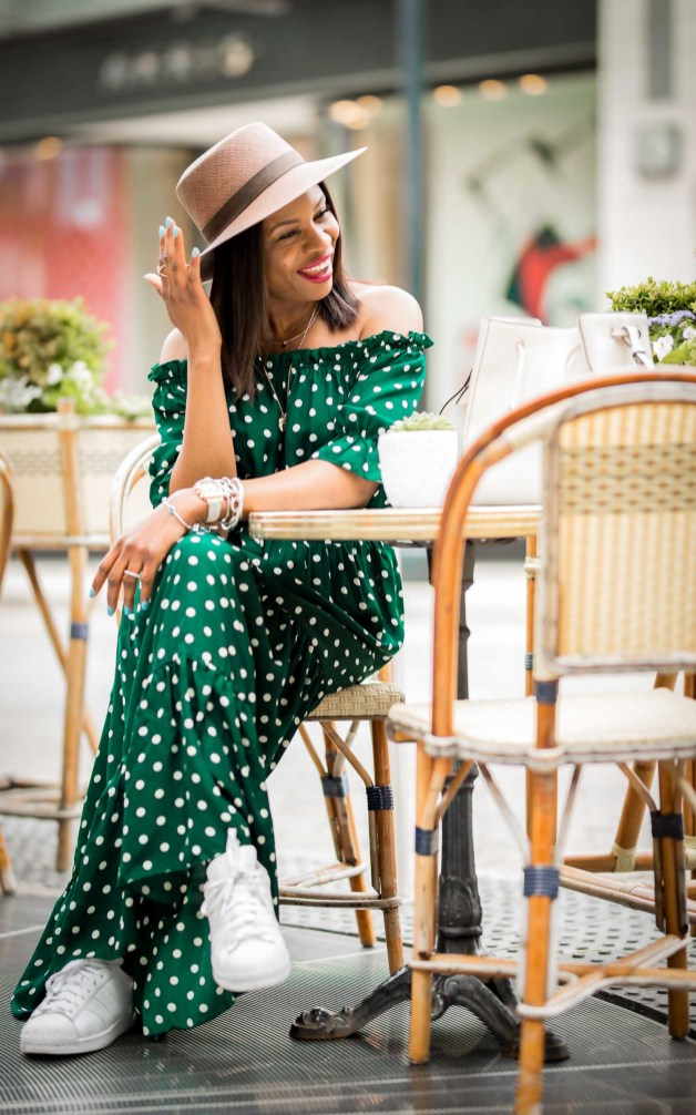 how to wear dots for spring. green and white dot maxi dress worn with white henri bendel bag, straw hat and white sneakers by atlanta fashion blogger. images taken at the shops buckhead atlanta-7