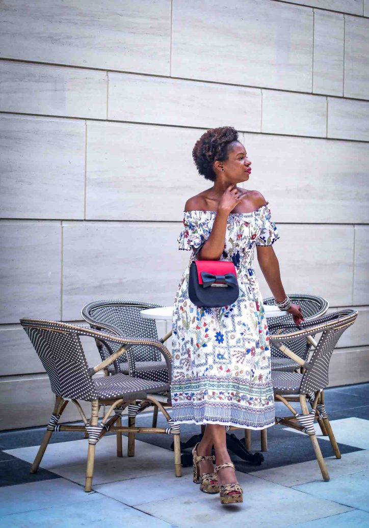Atlanta fashion blogger wearing the Kate Spade Byride bag featuring the red and black bow flap