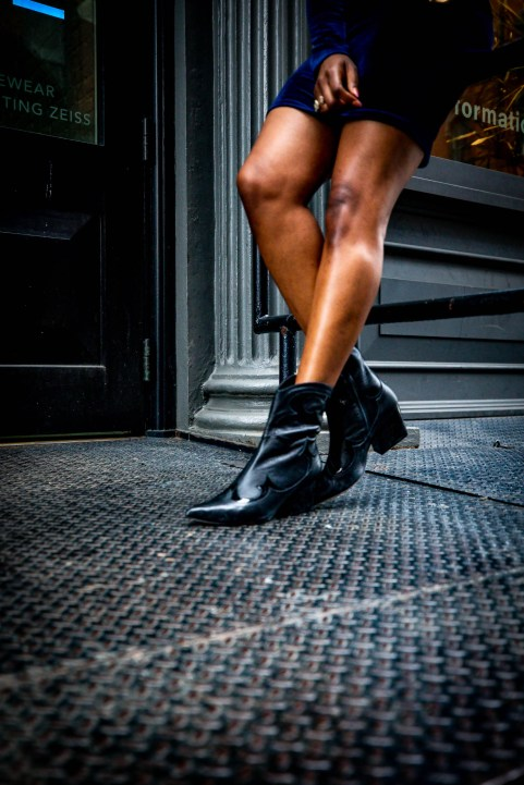 Fashion blogger Monica Awe-Etuk in a blackhalo navy velvet mini dress, dior saddle bag, dior logo strap and tibi cowboy boots-6