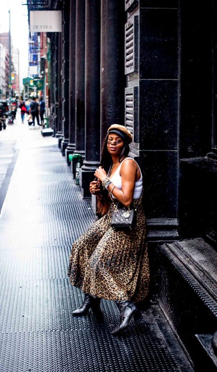 Fashion blogger Monica Awe-Etuk styles an asos pleated leopard midi skirt and cowboy boots-2