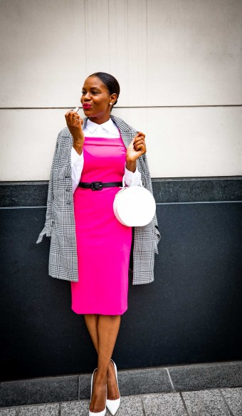 Fashion blogger Monica Awe-Etuk wearing a pink dress and plaid jacket from stage in celebration of breast cancer awareness month-10