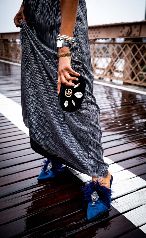 Atlanta lifestyle blogger Monica Awe-Etuk on the brooklyn bridge in new york city weaing a long metallic dress, gucci belt bag and tory burch feather mules-10