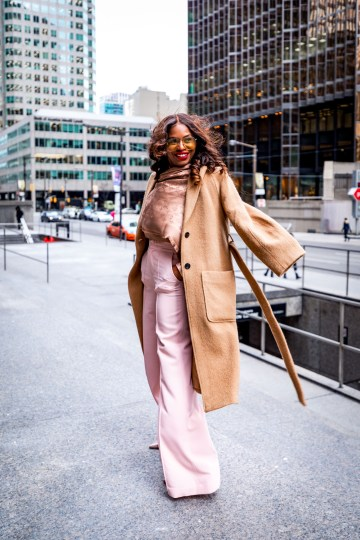 Atlanta blogger Monica Awe-Etuk wearing a Louis Vuitton scarf, camel coat, square gucci oversized sunglasses, blush alice and oliva pants and valentino rockstud pumps shot downtown toronto-12