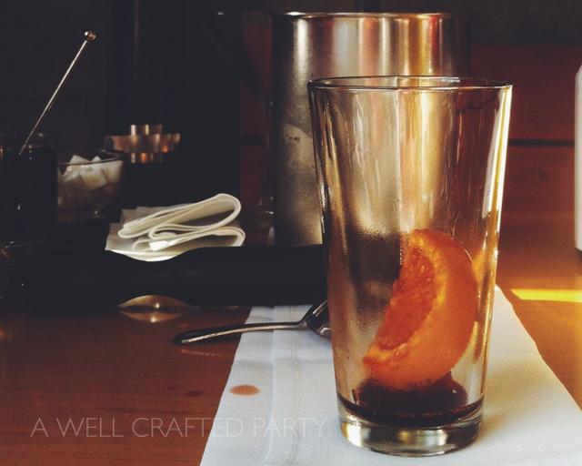 orange, cherry, bitters in glass