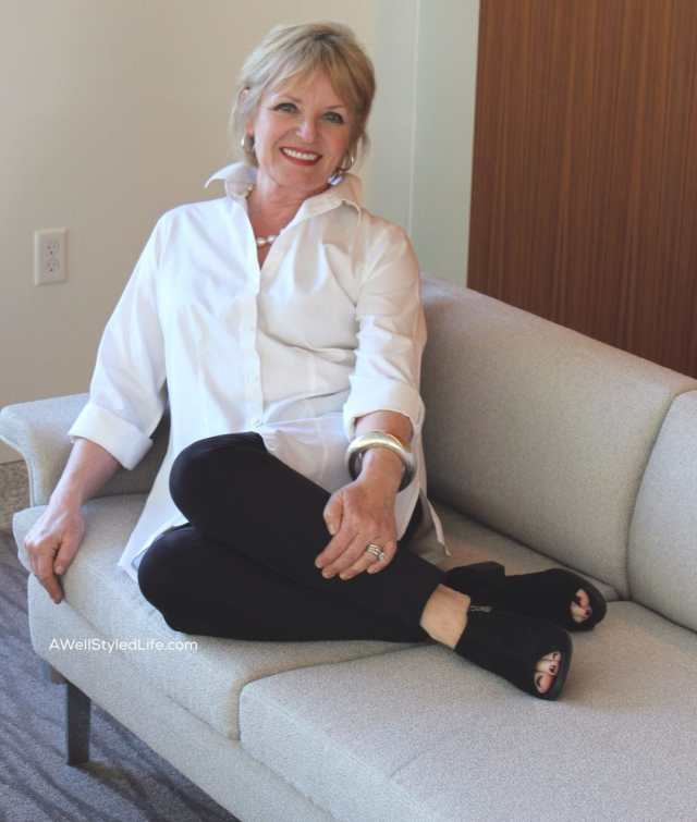 Jennifer Connolly of A Well Styled Life wearing white shirt and black pants