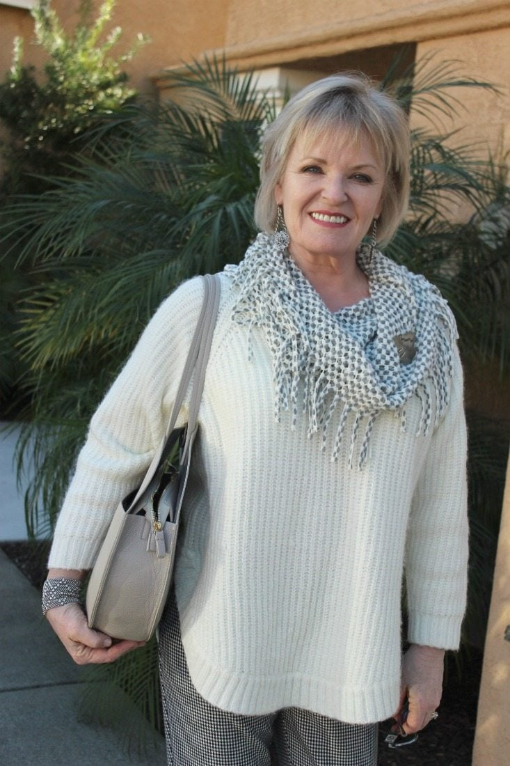 Jennifer Connolly of A Well Styled Life wearing Ivory sweater and gray cowl with French Kande earrings