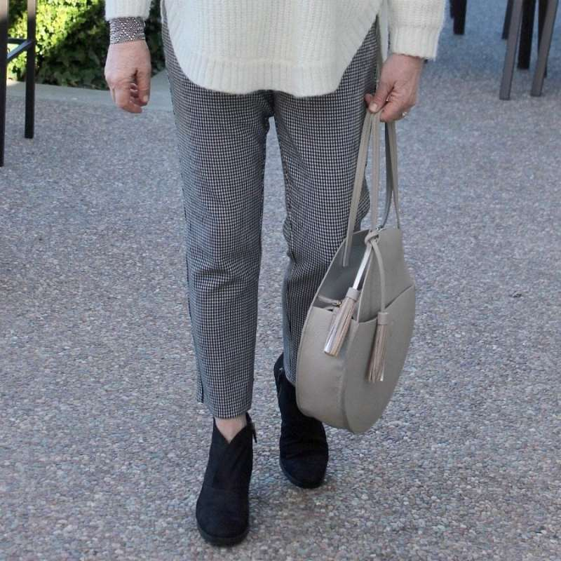 Jennifer Connolly of A Well Styled Life wearing houndstooth pants from Ann Taylor and black booties