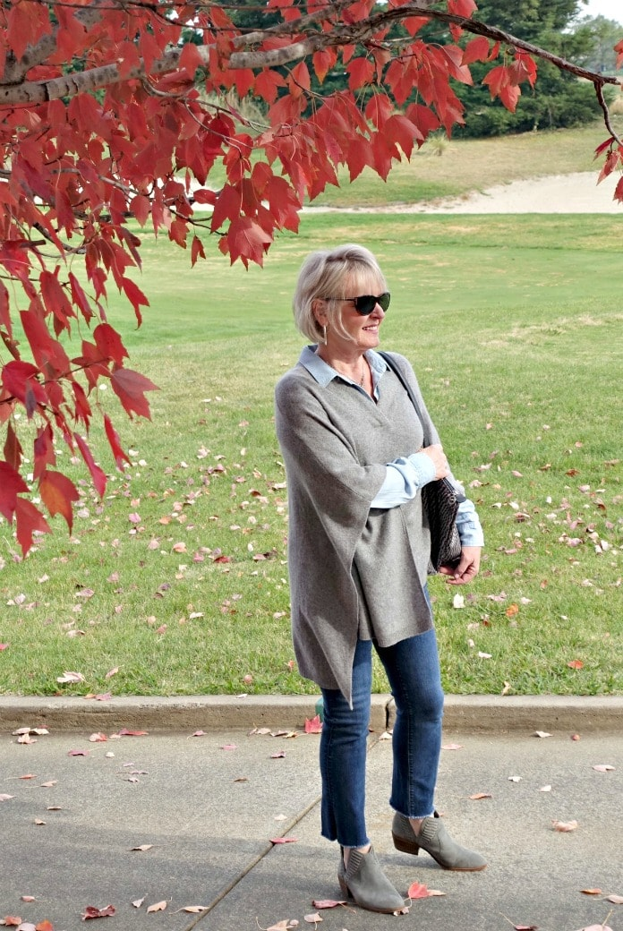 Gray cashmere poncho over double denim on A Well Styled Life