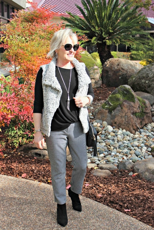 jennifer connolly of a well styled life styling gray mini check pants with black sweater and booties