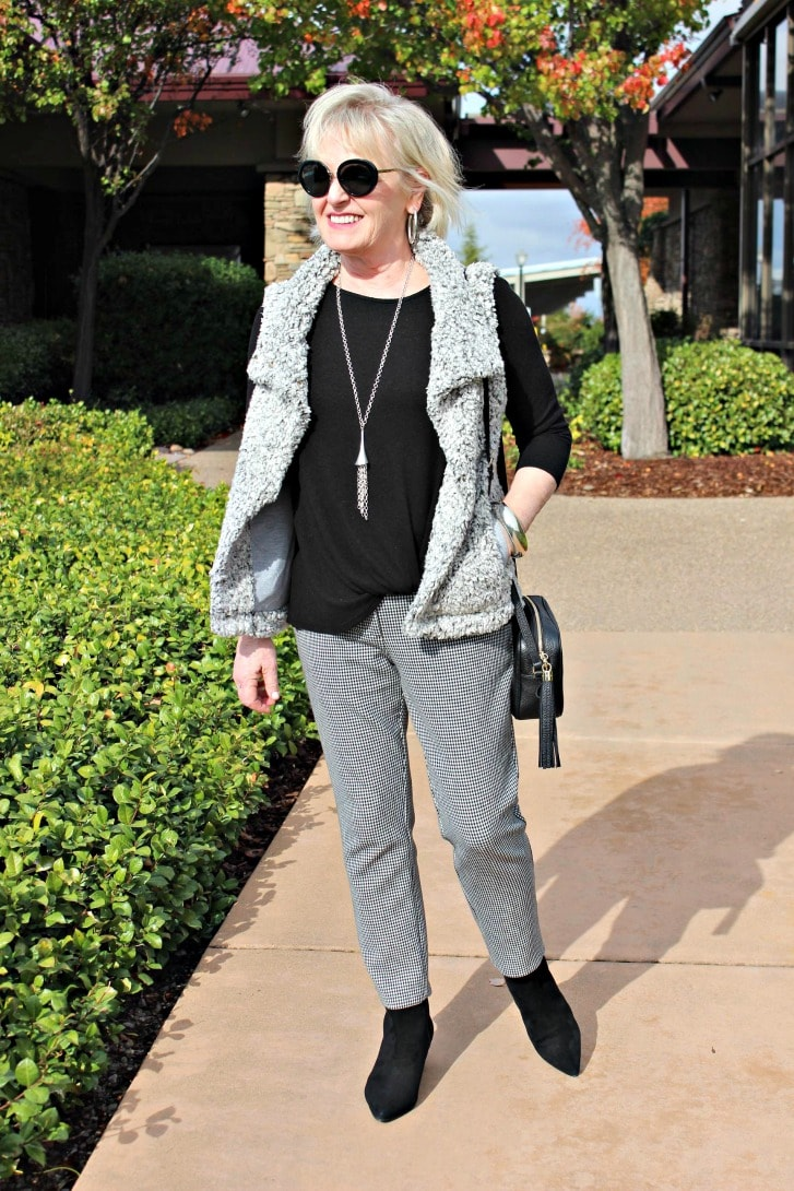 jennifer connoly of a well styled life wearing gray asymetrical vest over black and white checked pants