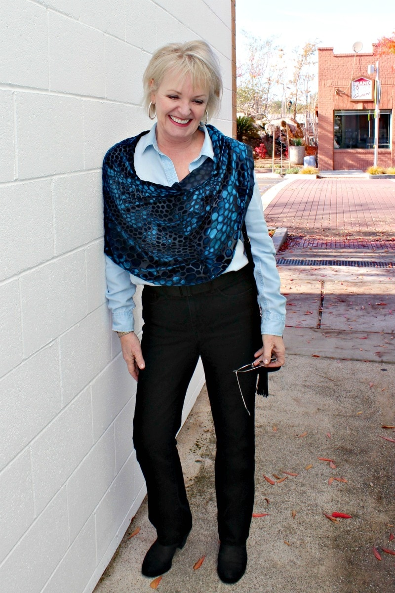 Jennifer connolly of a well styled life wearing velvet cape over black jeans and chambray shirt