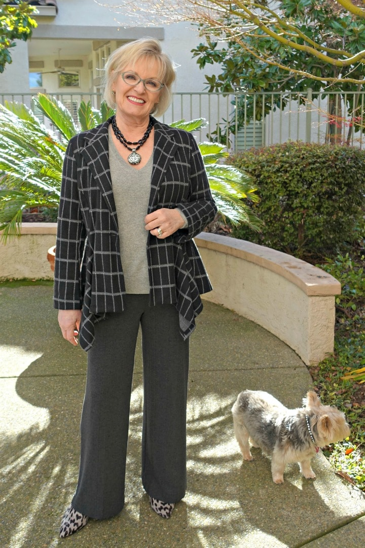 Jennifer Connolly of A Well Styled Life wearing leopard booties, gray slacks, and leopard necklace to show 5 ways to wear leopard