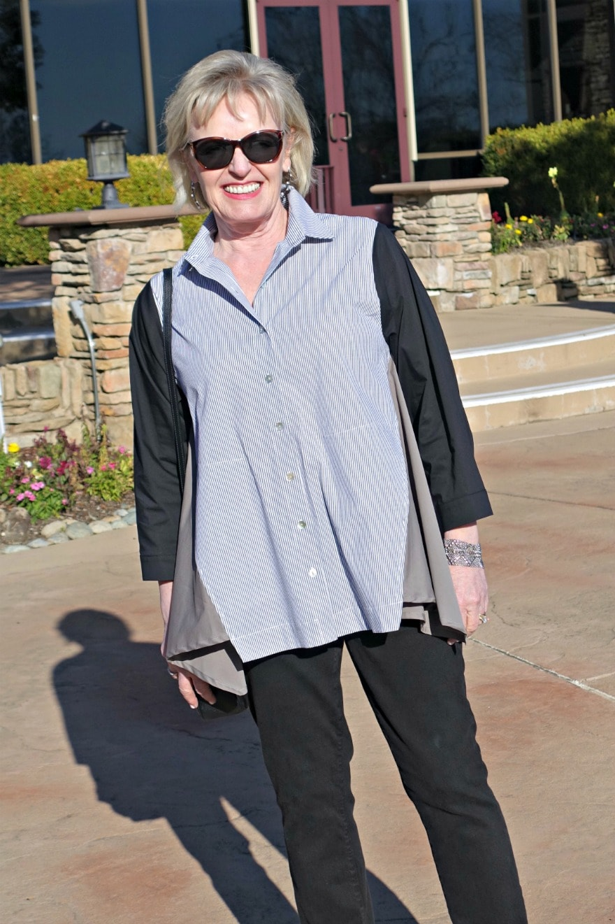 Jennifer wearing black and white shirt from Alembika with parker smith black jeans