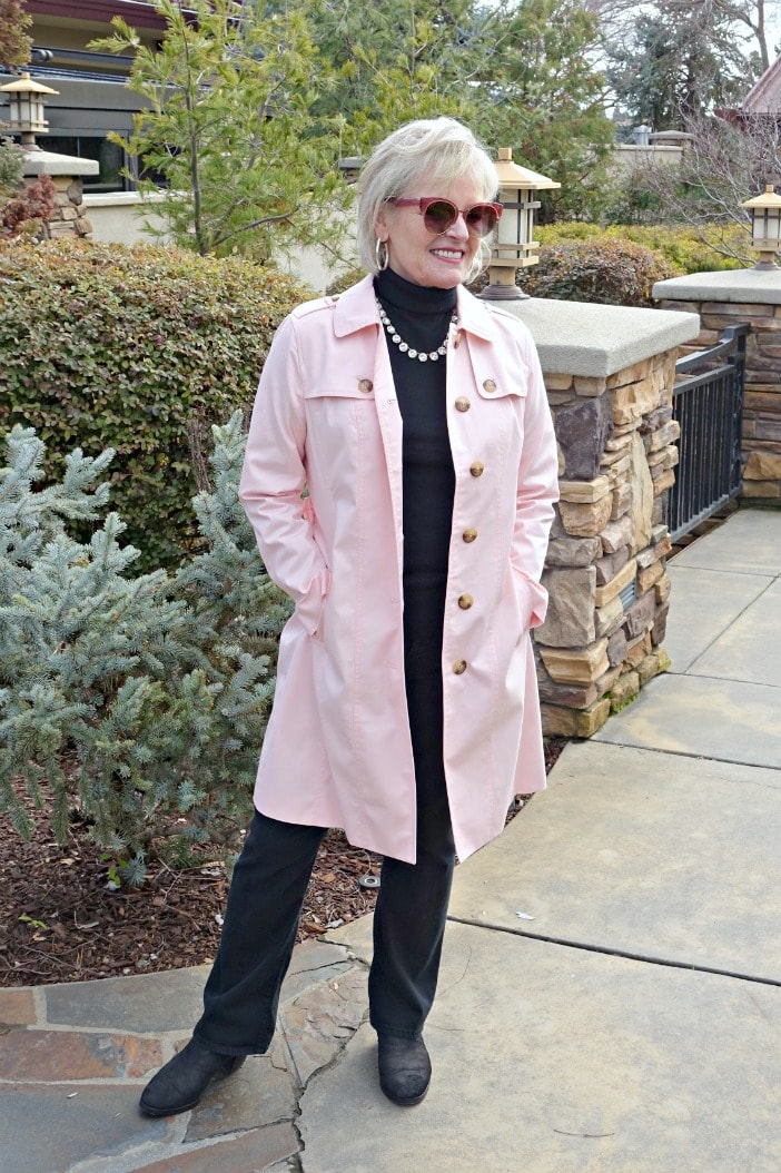 Jennifer of A Well Styled Life wearing Modern Trench in pink from Talbots over black NYDJ jeans and J.Crew black turtleneck