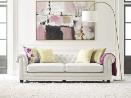 white leather tufted sofa with low back and rolled arms ...
