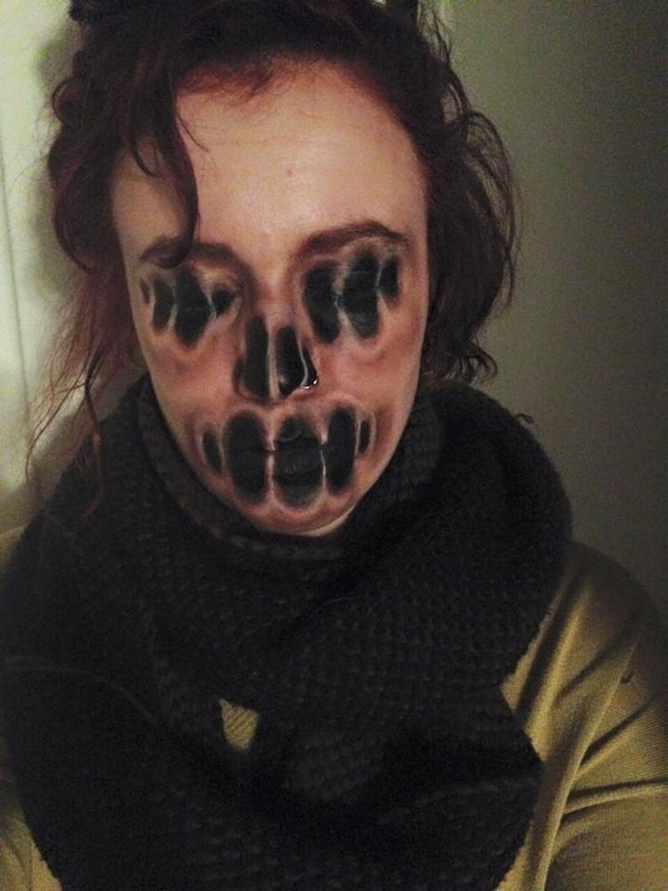 This Girl's Use Of Face Paints Is Both Creepy And Awesome
