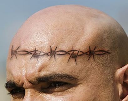 Barbed wire on forehead tattoo