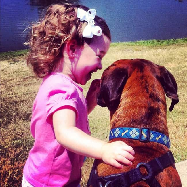 kid-sharing-secrets-with-pet-adorable-photos