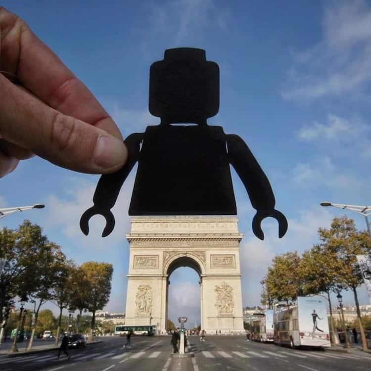lego-man-cutout-arc-de-triomphe-legs-visually-pleasing-photos