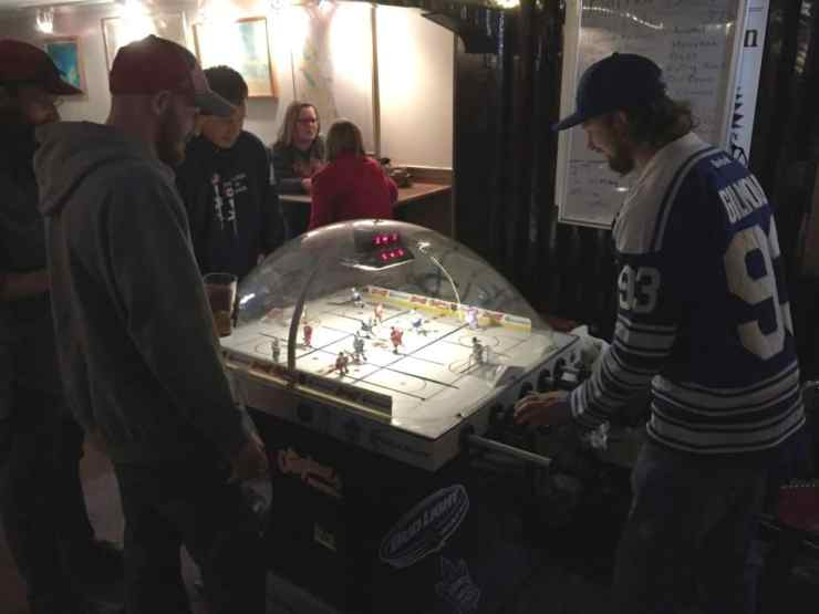Hockey fans enjoy the Red Wings season opener at Latitudes Tavern in Alpena. Photo by Joel Heckaman - Awesome Mitten #MittenTrip