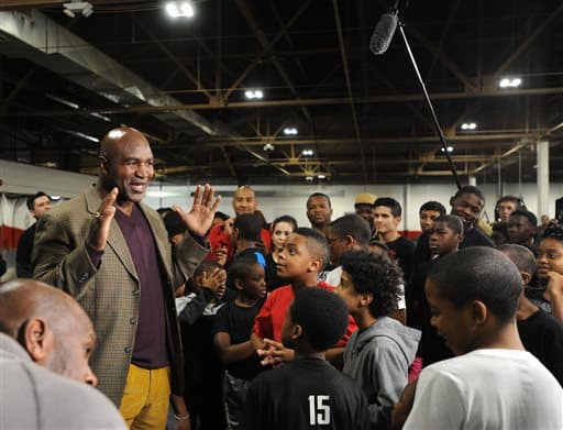 Former heavyweight boxing champion Evander Holyfield speaks with youth at the Downtown Boxing Gym (Photo by Brandy Baker/Detroit News via AP).