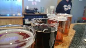 Looking for the best Michigan winter craft beers. A flight at Tri City Brewing