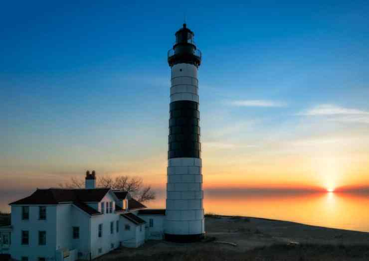 Big Sable Point Lighthouse is a great place to catch a Ludington sunset. Photo courtesy of Cody Shanely