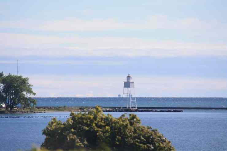 View of the Grand Marais bay and lighthouse - Upper Peninsula Road Trip - The Awesome Mitten