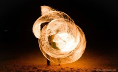 Fire poi dancer. We sat in front of him, the same one, for five days straight at sunset. He was incredible talented!