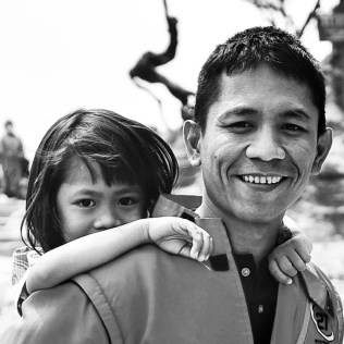 Who is happier when a father gives a piggy back ride to the daughter? Him or her, it is up to you (in Tangkuban Perahu)