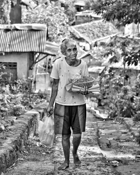 07:00 AM. Yogyakarta. Pictured this lady going uphill with a basket full of groceries.