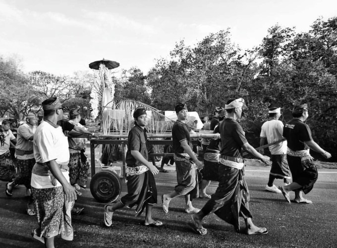 Passed this burial procession on our way back to Kuta a few days back. Mind the highway! In Kuta, Bali.