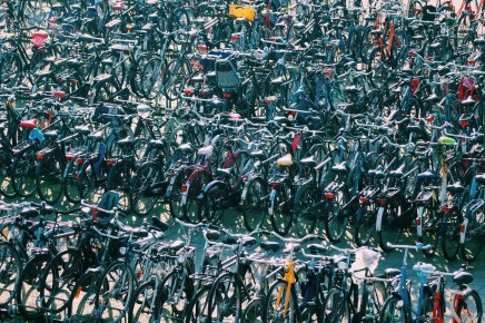Bike parking - How To Reduce Your Carbon Footprint When Traveling - A World to Travel