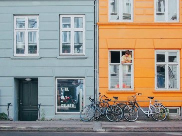 Bikes parked in a random and colorful street - Copenhagen must see - Denmark - A World to Travel