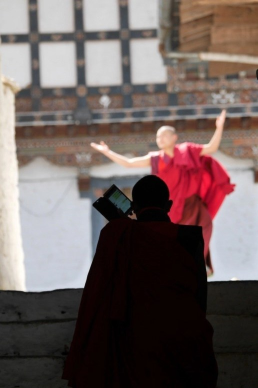 Traditional dance and whatsapp conversation - Two Bhutanese monks