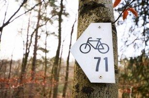 A detail of a Mullerthal Trail sign for bikes - Luxembourg trails