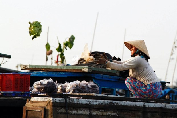 A flying lettuce in a floating market as seen in Vietnam